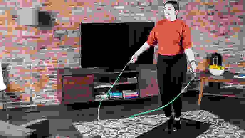 woman jumping rope at home.