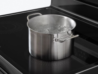 A pot of water boils quickly on a convection range