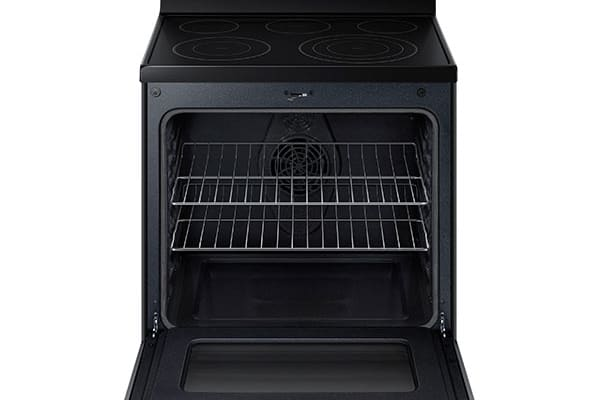 Interior shot. The NE59J7630SS ships with just two oven racks. Here we also see the single true convection fan.