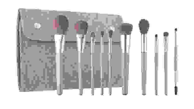 A 10-piece set of makeup brushes in front of a carrying case.