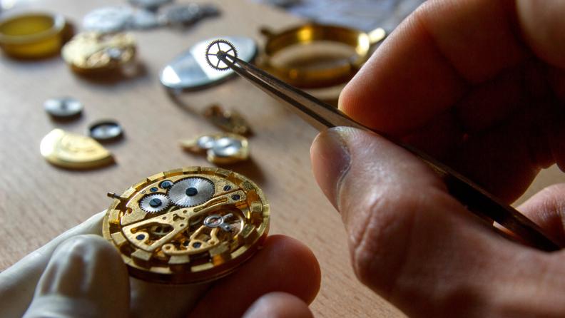 man working on repairing a mechanical watch