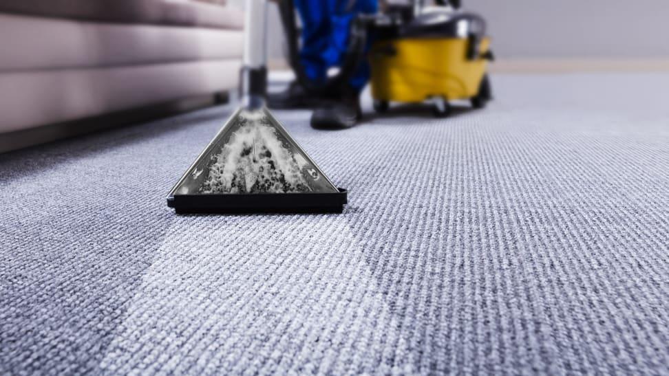 Man cleaning blue carpet