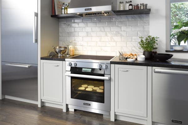 A 30-inch Miele induction slide-in. The focal point of this chrome, transitional kitchen.