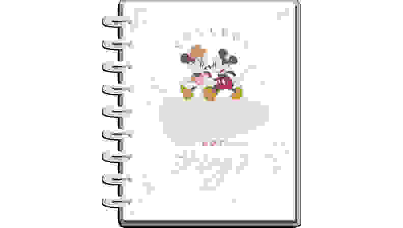 White journal with Disney Mickey and Minnie Mouse on a white background