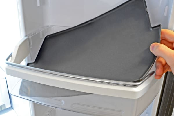 Rubberized mats found on the GE Profile PFE28RSHSS's right door help keep food in place and ease spill cleanup.