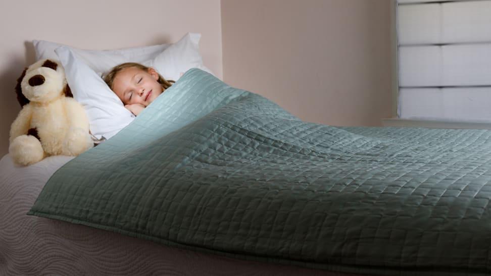 Girls sleeping under gravity blanket