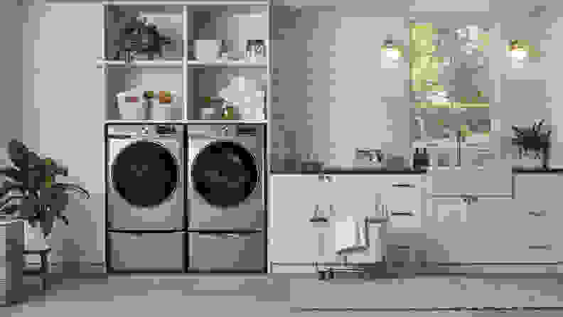 The Samsung WF45R6300AV beside a Samsung washer in a cream laundry room.