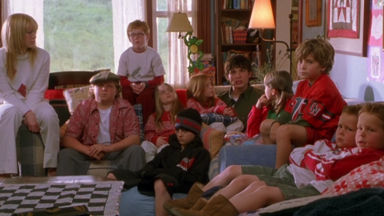 A still from 'Cheaper by the Dozen' featuring all of the Baker kids on a couch.
