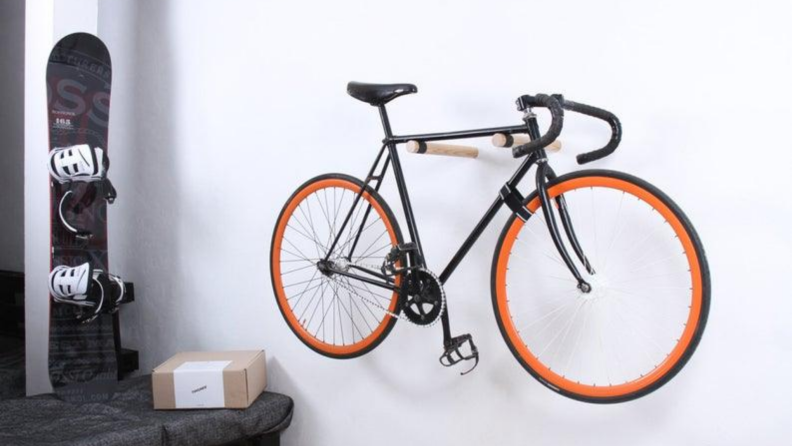 Bike resting on wooden bike mounts parallel to the wall