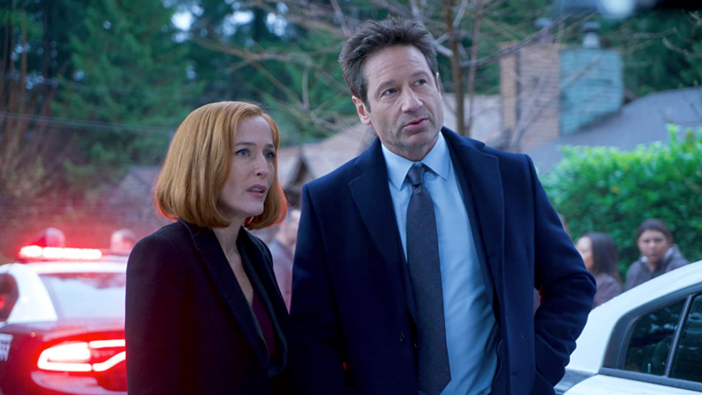 A still from the rebooted season of the X-files featuring Scully and Mulder standing in front of a crime scene.
