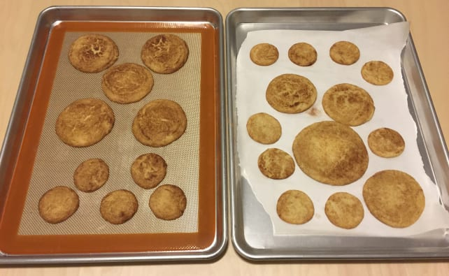 Baking mat and parchment paper on pans