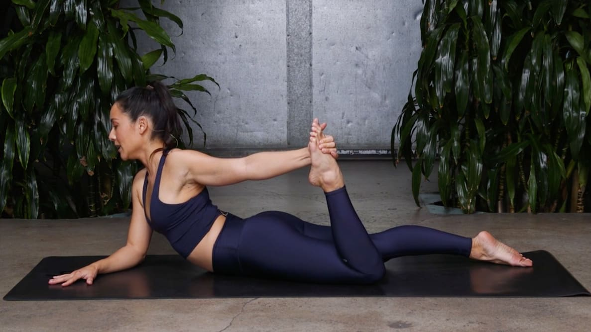 A woman practicing yoga.