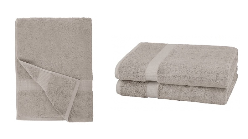 The Pinzon Organic cotton towel in grey folded in two different ways.