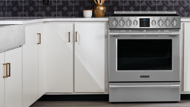 A Frigidaire Professional PCFE3078AF electric range, nicely fitted into the white cabinets of the kitchen.