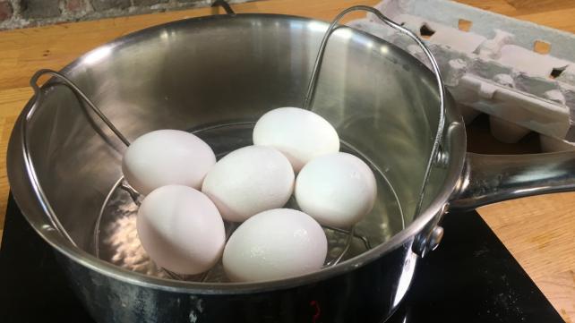 Steaming Eggs in Basket