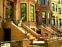 Brownstone apartments with stoops in front.