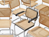 Multiple Cesca chairs against a white background