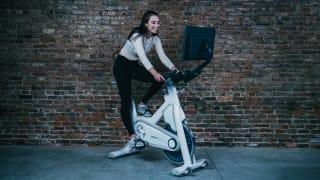 woman sitting on myx exercise bike