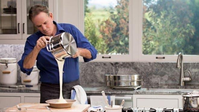 Thomas Keller pouring baking mix in a light kitchen