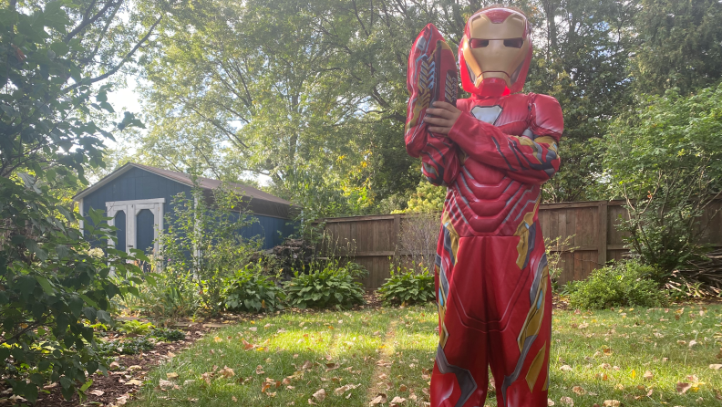 A boy dressed up in an Ironman costume