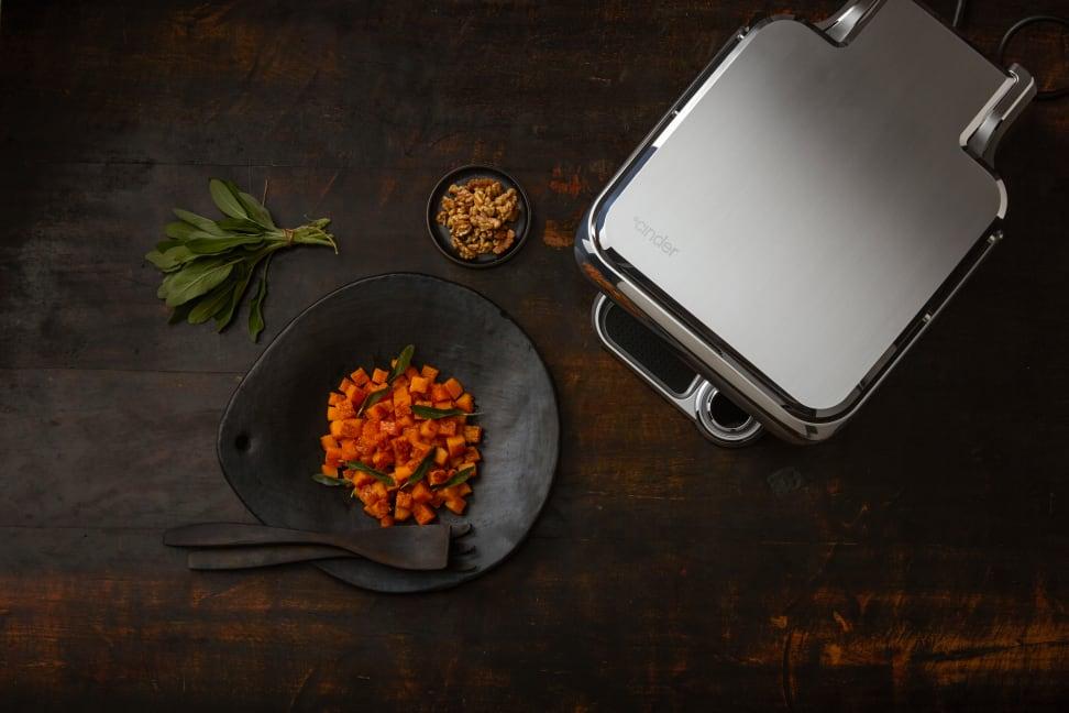 The Cinder Sensing Cooker next to a vegetable desk