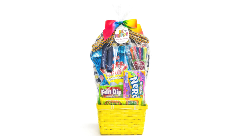 A yellow Be Hoppy basket includes jump rope, water balloons, and candy.