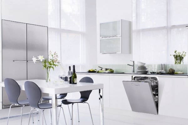 The stainless steel D5894SSXXL Style Series dishwasher, set in a spare, fully-integrated modern kitchen design.