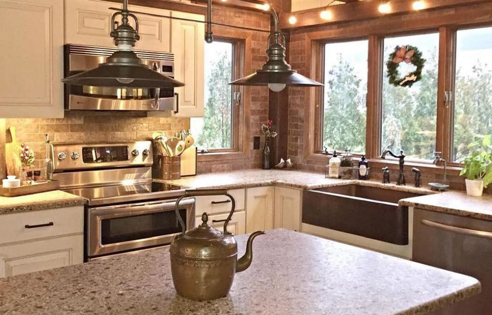 Kitchen with stainless appliances and copper sink