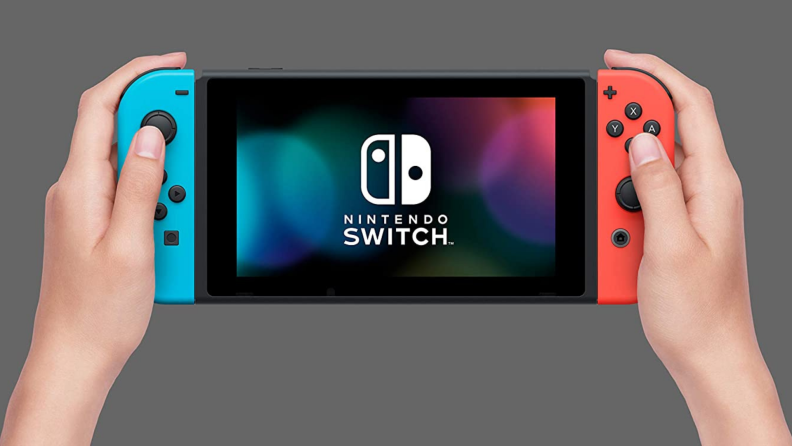 A person plays with the handheld Nintendo Switch.