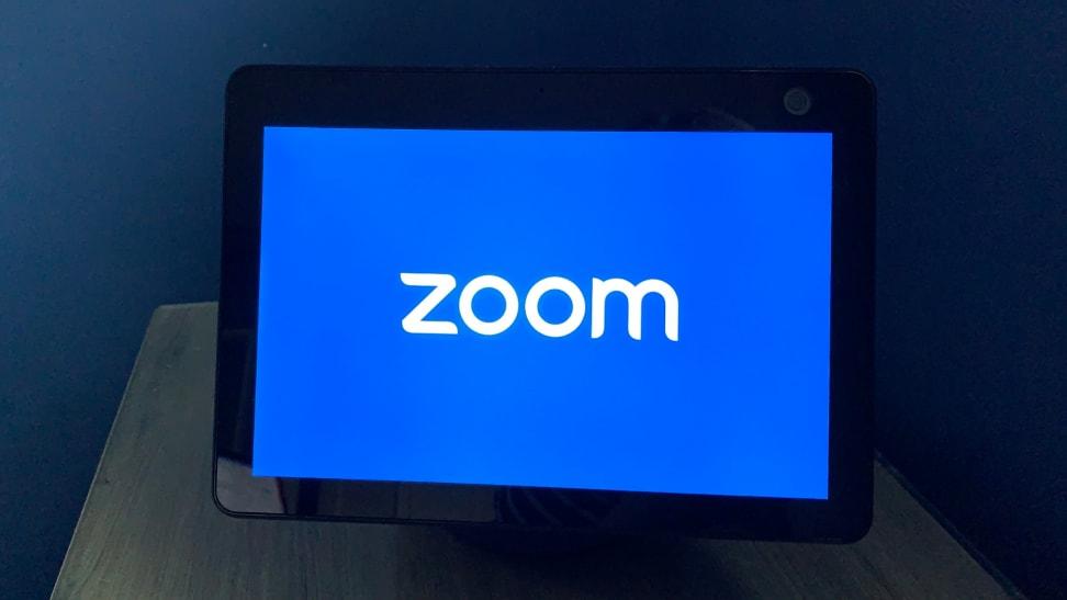 Amazon Echo Show 10 smart display sits on a nightstand.