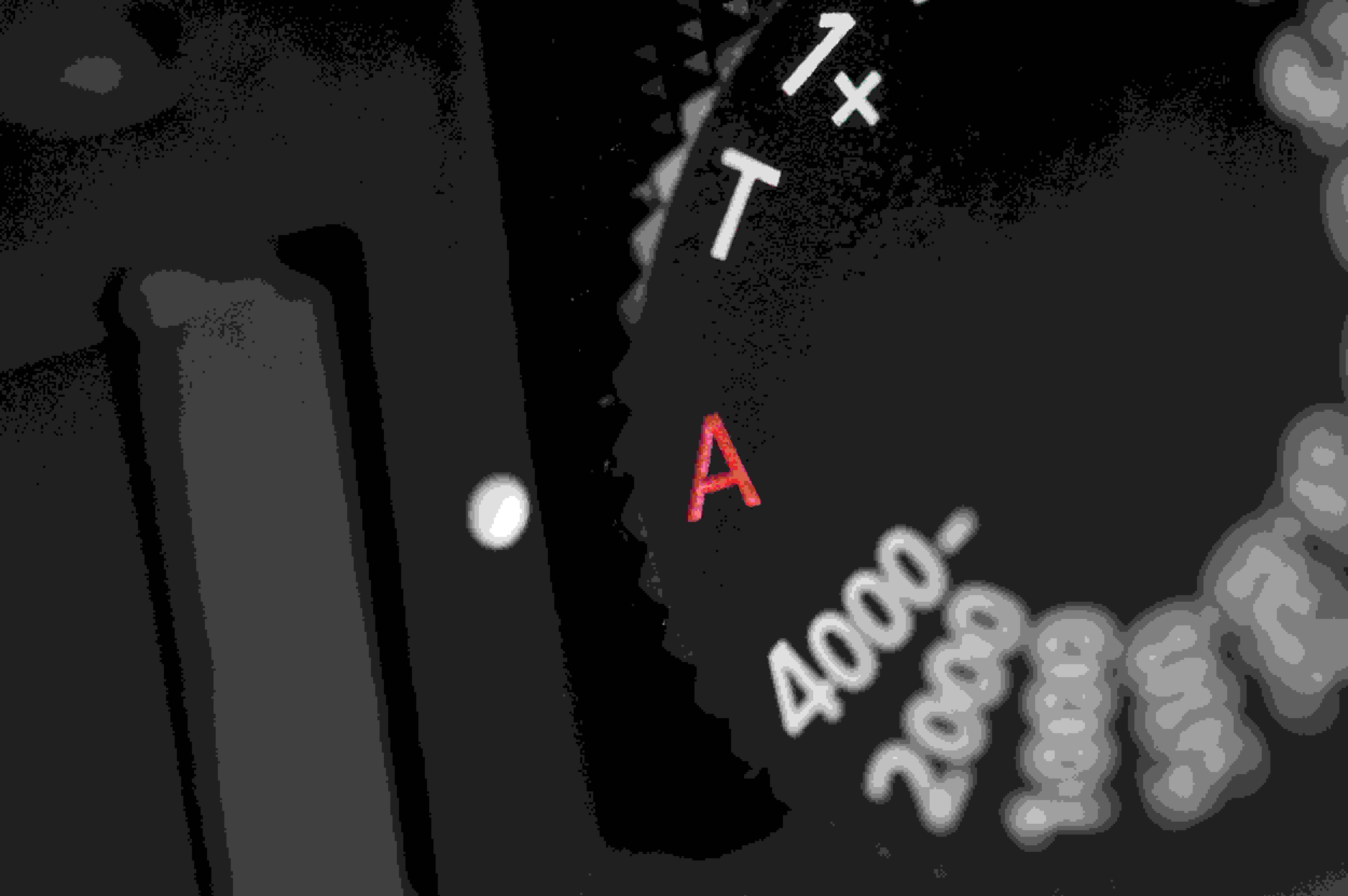 A photograph of the Panasonic Lumix LX100's shutter speed dial.