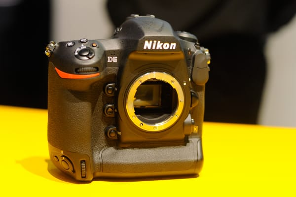 The Nikon D5 has a few minor physical changes from the D4S, but otherwise it's a very recognizable camera.