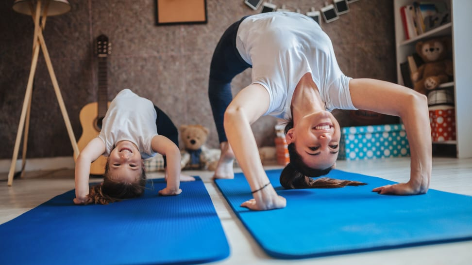 Boy and girl doing yoga at home
