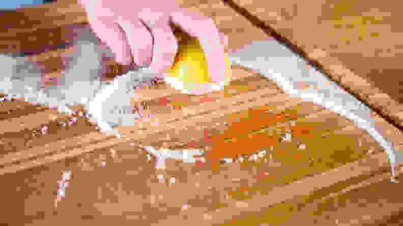 Clean a wood cutting board - scrub