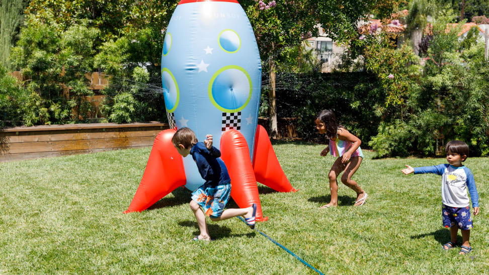 Kids playing in a giant rocket ship sprinkler