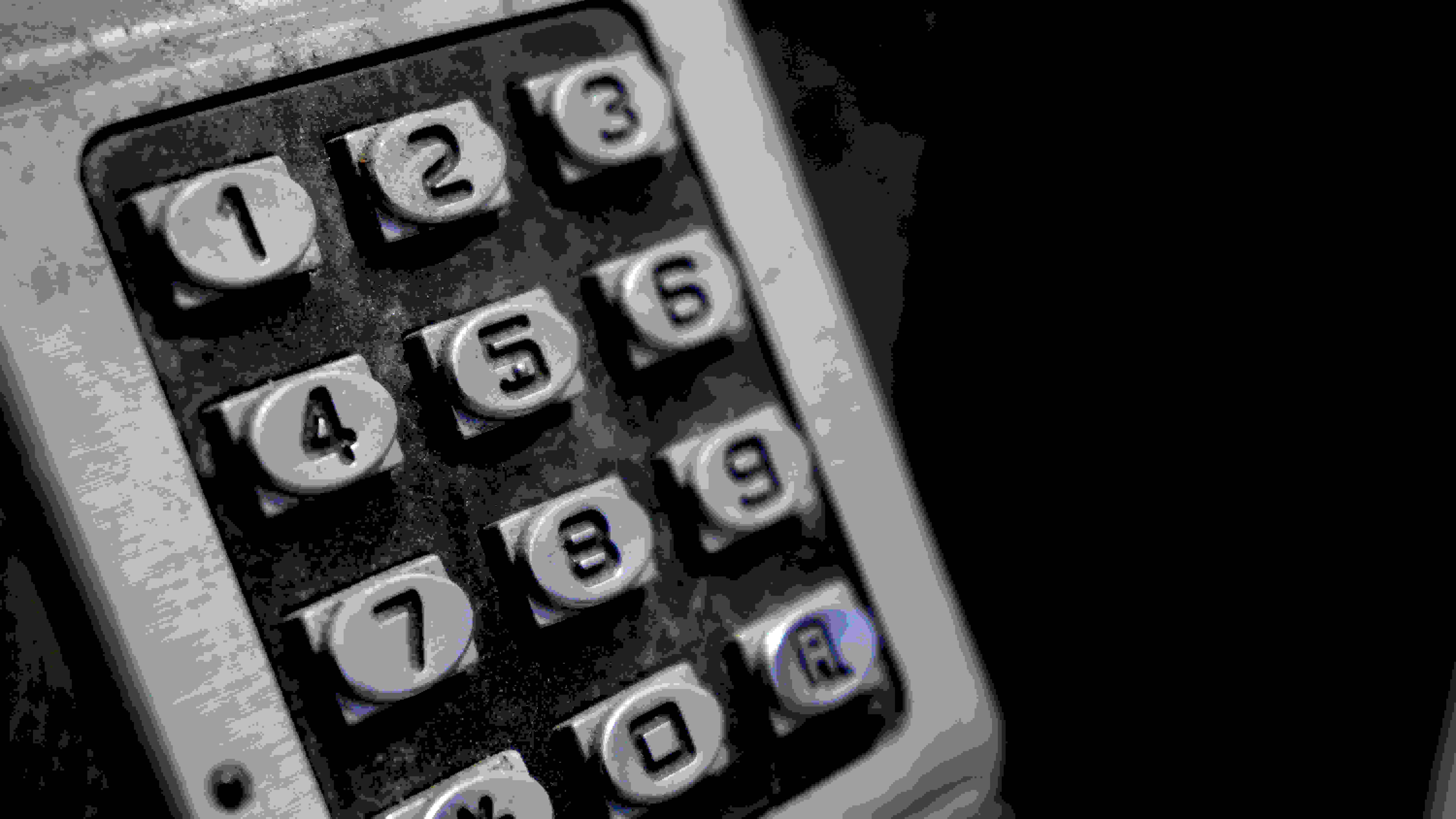 The 16-50mm lens isn't a macro lens, but it lets you get close enough to pick up fine details like the dirty on this keypad.
