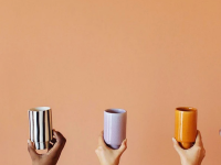 Five hands hold up different colored ceramic cups
