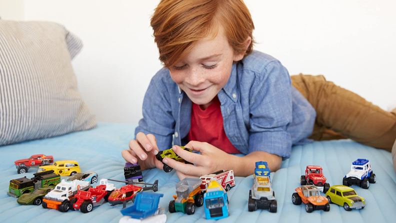 Little boy playing with Matchbox cars