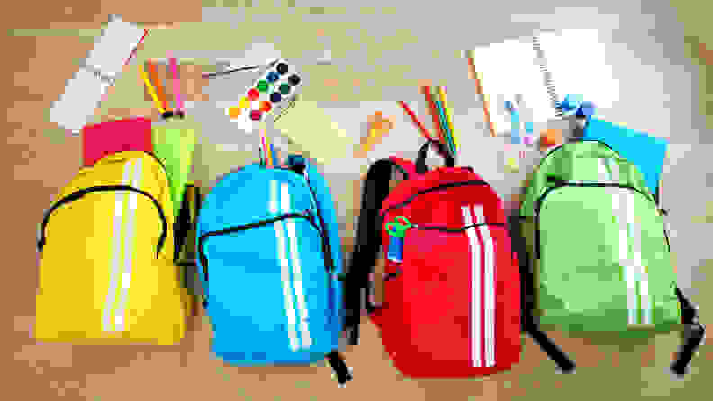 Four backpacks filled with school supplies