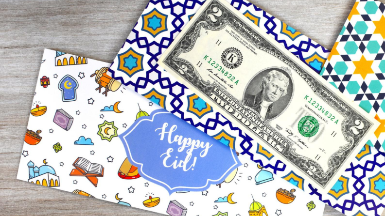 A festive envelope and a $2 bill.