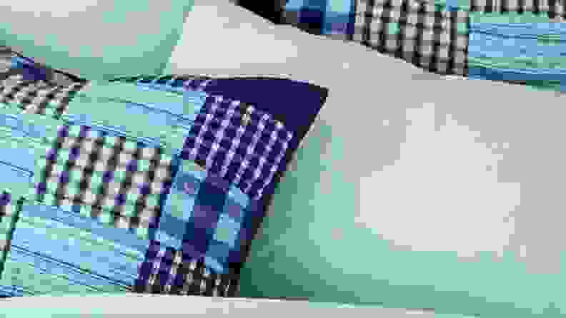 land's end flannel sheets on a bed with a navy patchwork quilt