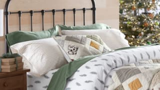 a bed made with a quilt, duvet, and flannel sheets from Garnet Hill