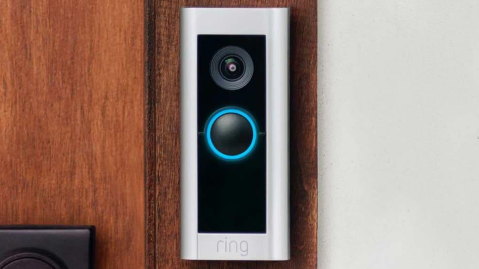 The Ring Video Doorbell Pro 2 hangs on a wooden front door.
