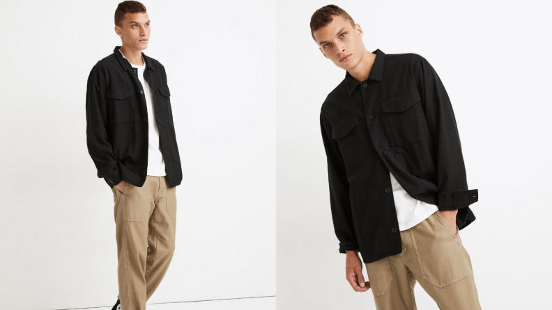 Man wearing khaki pants and oversized black military jacket from Madewell.