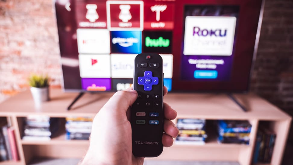 The 65-inch TCL 6-Series with the Roku remote control in the foreground