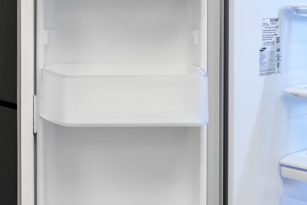 The Samsung RF260BEAESR's left fridge door features three adjustable shelves large enough to hold gallon-sized containers...