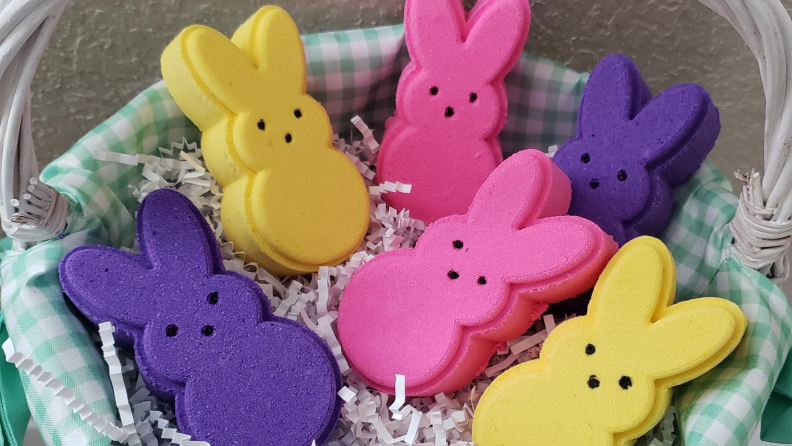 Basket full of Peeps bath bombs in yellow, purple, and pink