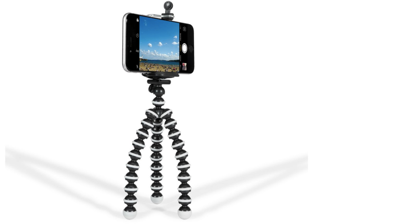 A phone held up in a small tripod with flexible legs