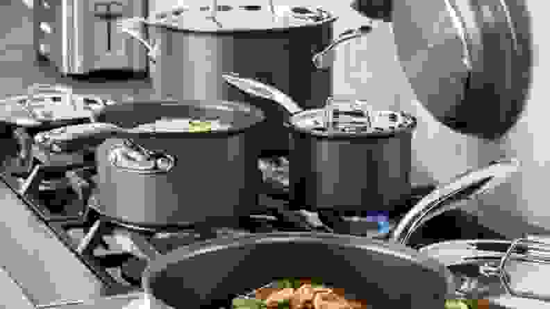 Pots and pans cooking on a stove