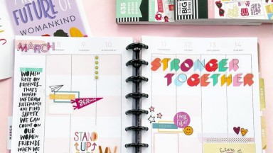 A colorful planner from Happy Planner with stickers.